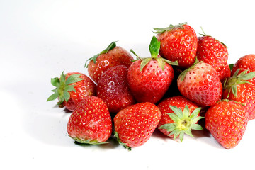 Red strawberry on white background and space for write wording, popular western fruit feed in higher part of Thailand, feel good meaningful fruit for love especially for valentines events