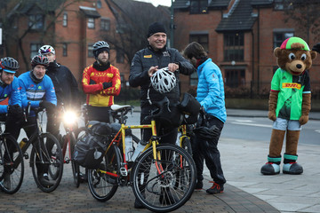 Former rugby player Ron Rutland adjusts his bike helmet outside Twickenham Stadium before setting off on a cycle ride from London to Tokyo ahead of the Rugby World Cup, in London