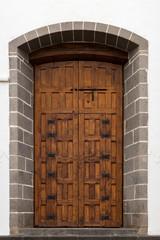 Old grunge wooden door of a church