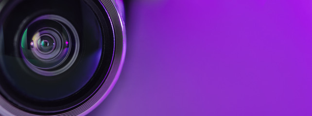 Banner. The camera lens and light lilac color.