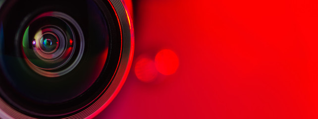 Banner. The camera lens and  red background.