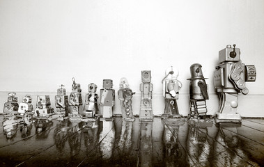 vintage toy robots from small to big in solarized monochrome