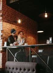 Young couple in loft cafe