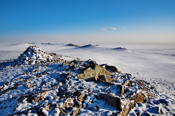 Western Mongolia. Highlands near the city of Altai after a night snow storm.