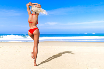 3D beautiful sun-tanned woman red swimsuit bikini on sea beach. Summer rest. Blue ocean background. Sunny day. Conceptual fashion art. Seductive candid pose. Realistic render illustration.