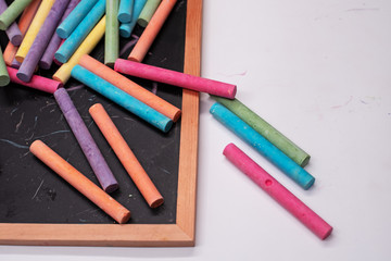 The colorful chalks put on blackboard