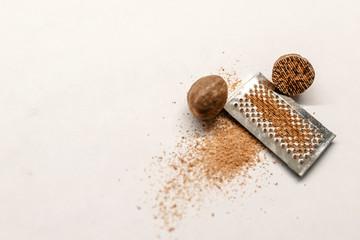 Fototapeta Nutmeg. Whole nut, half and powder isolated on white background. obraz