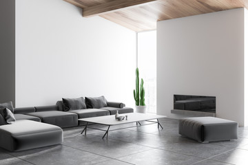 White living room corner, gray sofa