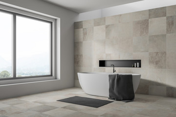 Beige bathroom corner with tub