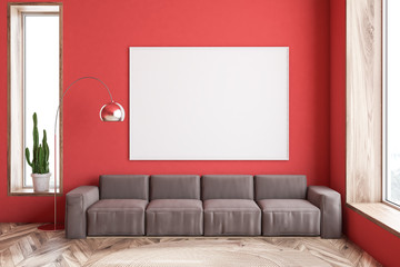 Red living room, brown sofa and poster