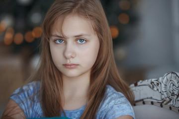 Cute, pretty blonde teen girl in a blue dress.