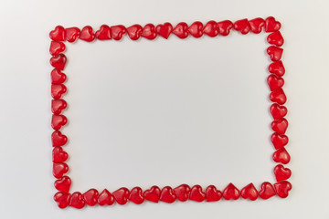 greeting card made of red glass hearts on a white background. Valentine's Day. copy space