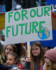 A girl display a placard during a demonstration against climate change in Zurich