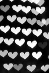 Silver background with bokeh hearts