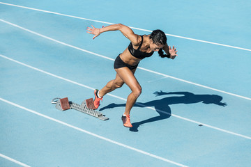 young woman training on running track