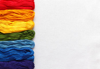 Rainbow color threads are listed in a row.
