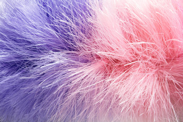 Abstract violet-pink background of artificial hairs. Close-up shot.