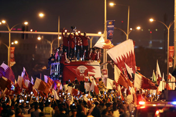 Qatar players celebrate with the trophy after winning the Asian Cup in Doha