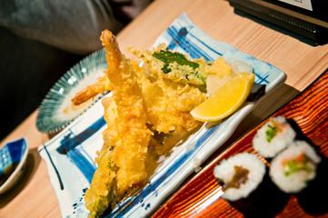Tempura prawns and sushi at traditional japanese restaurant