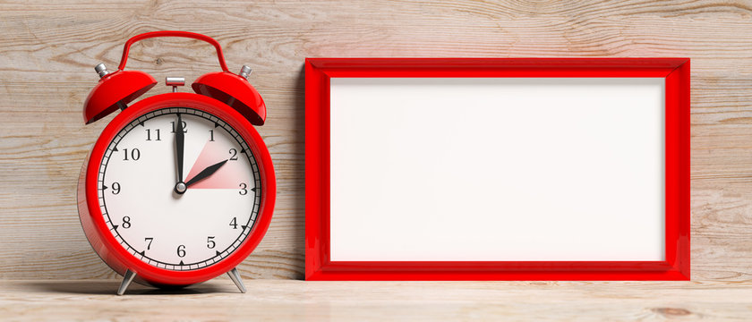 European daylight saving time. Red alarm clock and blank frame isolated on wooden background, banner. 3d illustration