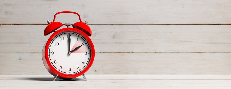 European daylight saving time. Red alarm clock on white wooden background, banner. 3d illustration