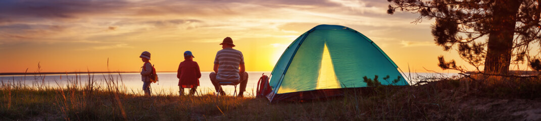 Spoed Foto op Canvas Kamperen Family resting with tent in nature at sunset