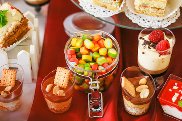candy bar closeup at wedding table. Sweets for guests