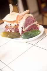 Kosher deli combination sandwich pastrami corned beef tongue cole slaw and Russian dressing on seeded Jewish rye bread
