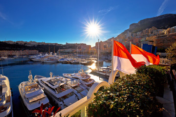 Monte Carlo yachting harbor and colorful waterfront sun haze view