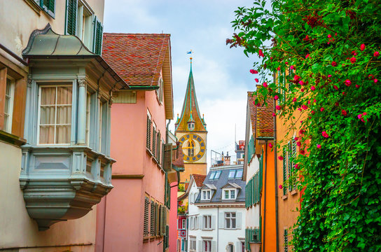 Beautiful cozy street and tower of Saint Peter church in the city center of Zurich, Switzerland