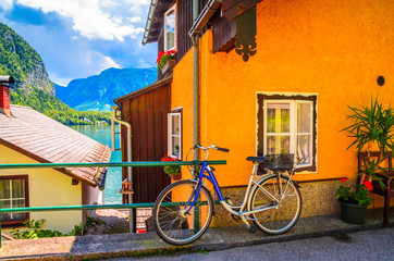 Wall Mural - Austrian Alpine house with bicycle in Hallstatt village, Austrian Alps,  Salzkammergut, Austria, Europe