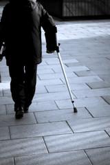 Unknown senior person walking on crutches