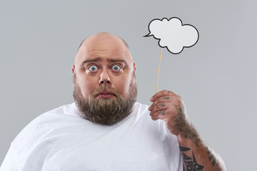 Close up of man with thought cloud expressing surprise