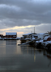 Traditional village houses covered with snow on the waterfront of the Lofoten islands-Norway.