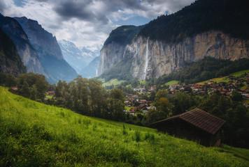 Gloomy view of alpine village. Location place Swiss alps, Lauterbrunnen valley.