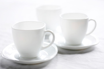 White cup for tea. Clean dishes symbol of purity