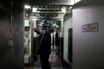 Michael Pittser takes a photo with his phone during a tour of the 103-foot Titan II ICBM site which was decommissioned in 1982, at the Titan Missile Museum in Sahuarita