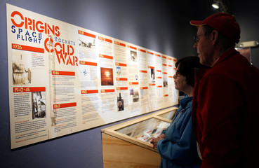 Tom Pollock and Helen Pollock read a Cold War timeline during a tour of the 103-foot Titan II Intercontinental Ballistic Missile (ICBM) site which was decommissioned in 1982, at the Titan Missile Museum in Sahuarita, Arizona