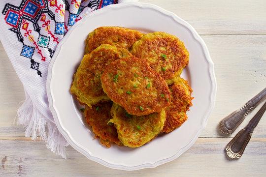 Potato Cakes. Vegetable fritters, latkes, draniki. Vegetable pancakes. horizontal, overhead