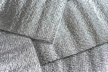 Metallic textile abstract background texture. Silver pattern
