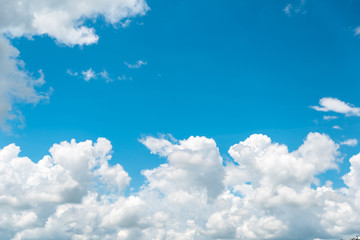 White and bright clouds on blue sky