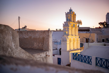 Bell tower in a village on Santorini, Greece at dusk