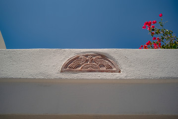 an architectural detail of a tile in stucco