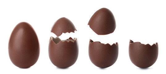 Set of different delicious chocolate Easter eggs on white background
