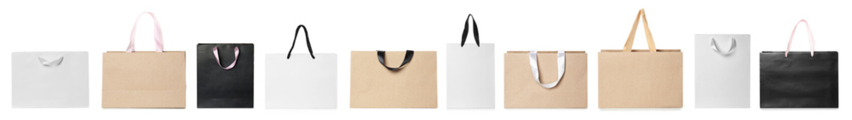 Set of different paper bags for shopping on white background. Mockup for design