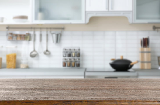 Empty brown wooden table in modern kitchen. Mockup for design