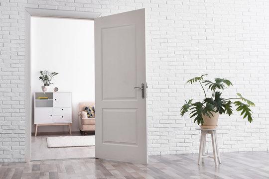 Room interior with new furniture, view through open door