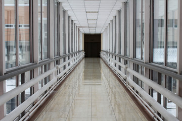 Corridor with a prospect and side large windows..