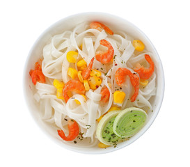 Bowl with rice noodles, shrimps and vegetables on white background, top view