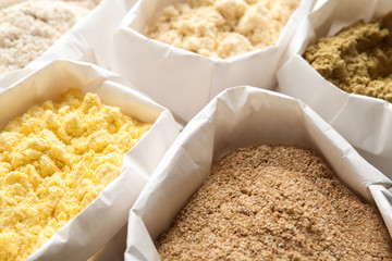 Different types of flour in paper bags